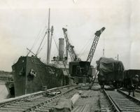1950s   Esparto Grass from Portugal being discharged for delivery to a local papermill
