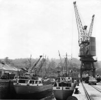 1950s  M.V. Zephyr (left) discharging sulphur for distribution to Courtaulds Greenfield Factory; M.V. Steady Kampen (right) loading cement