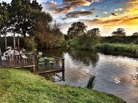 Sunset by the lake at Kings Acre wedding venue.