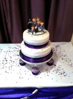 A traditional wedding cake with a topper made to last